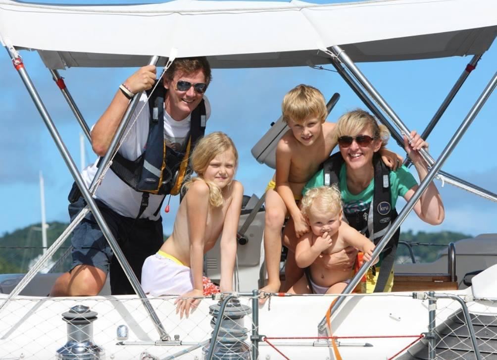 Naked family on boat